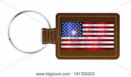 A brown leather key fob and ring over a white background with the United States of America flag
