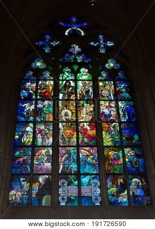 Prague - September 26 2016: Alphonse Mucha Stained glass window in St. Vitus Cathedral