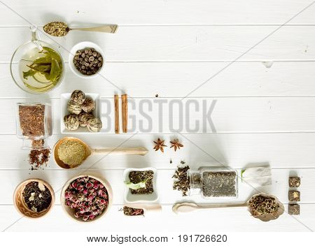 Collection of tea and measuring devices, different kinds of tea, copyspace, topview