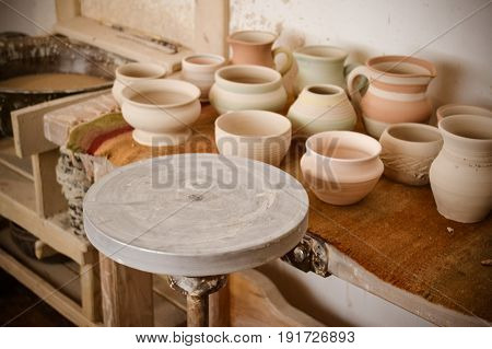 An empty circle, where the potter molds product close-up. Creative studio potter. Workplace wizard Crock pottery