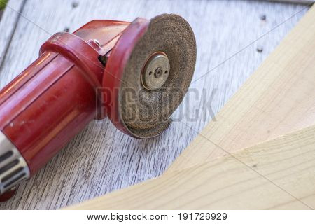 Carpentry Tools a red old electric sander