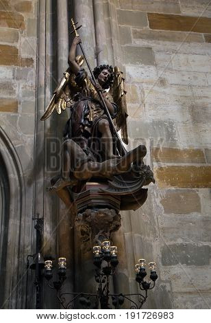 Prague - September 26 2016: Sculpture St. Michael slaying the devil in St. Vitus Cathedral.