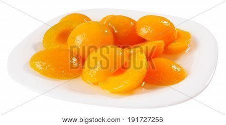 Apricot peeled halves with sugar syrup on plate isolated on the white background