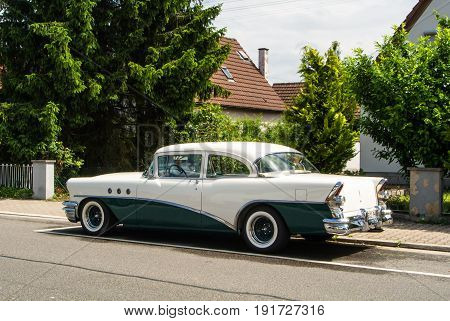 Walldorf, Germany - June 4, 2017: 1950S Buick Of White And Dark Green Color At The Street Of Walldor