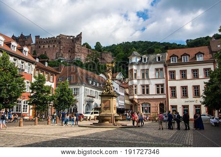Heidelberg, Germany - June 4, 2017: Heidelberg Touristic Central Square With A Fountain And A View T