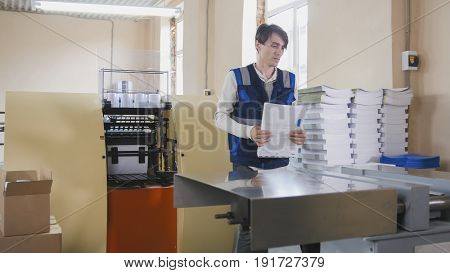 Printing process - feeding sheets of paper, polygraph industry, wide angle view
