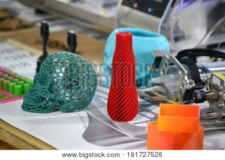 Bright colorful objects printed by a 3d printer close-up. Progressive modern additive technology. Copy spase, spase for text.