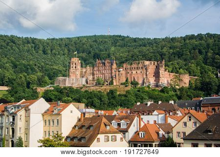 Panoramic View Of Heidelberg Castle Over The Tile Roofs Of Old Town From Carl Theodor Bridge, Heidel