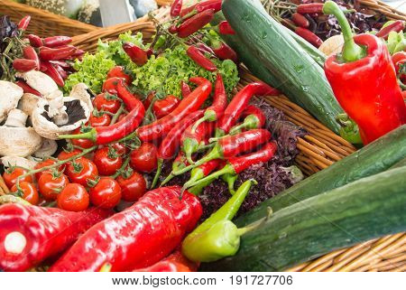 Fresh Vegetables: Tomatoes, Cucumbers, Lettuce, Peppers, Champignons In The Basket At The Street Far
