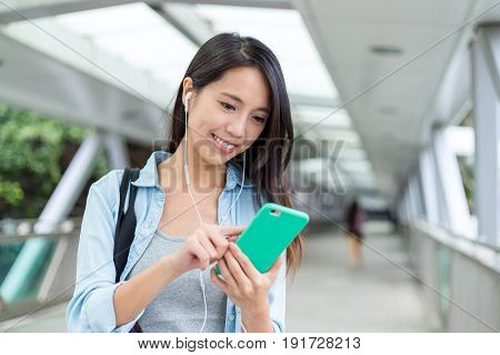 Young Woman listen to music on mobile phone