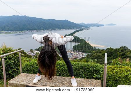 Woman viewing Amanohashidate with upside down posture