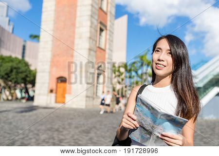 Woman travel in Hong Kong with city map