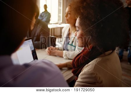 Profile of women in working team working together at laptop