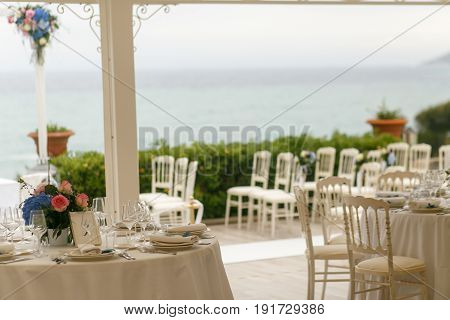 White Round Dinner Table Stand Before The Chairs For An Engagement Ceremony