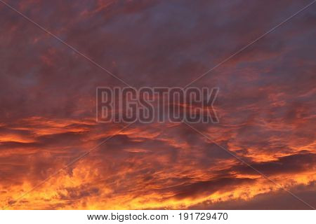 Dramatic sunset and sunrise sky. Colorful sunset with clouds in the evening