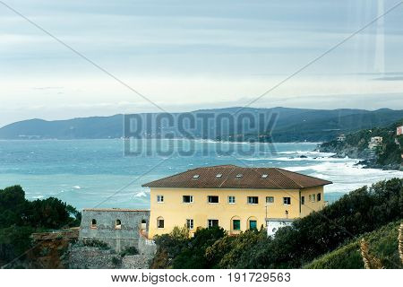 Look at the azure sea over the yellow house