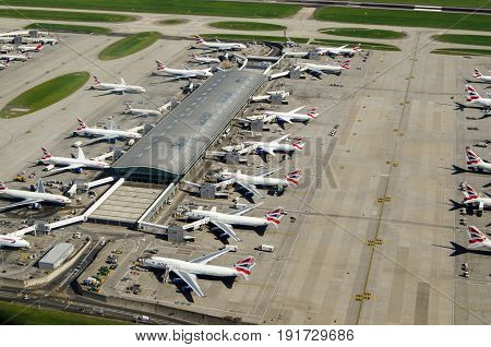LONDON UK - JUNE 3 2017: Aerial view of British Airways planes parked at Terminal 5 of London's Heathrow Airport on a sunny summer morning.