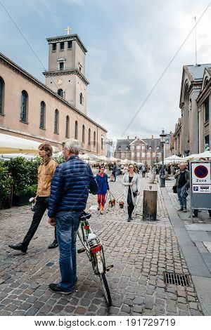 Copenhagen Denmark - August 11 2016. People in antiques flea market in Frue Square in Copenhagen. Frue Plads is a public square located on the north side of the Church of Our Lady in central Copenhagen