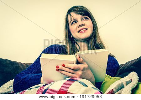 Young pretty woman reading a book at home - retro style