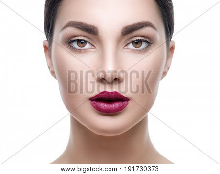Beauty Woman Face Portrait. Beautiful Spa Girl face with make up, makeup. Perfect Fresh Skin. Pure Beauty Model Female looking at camera closeup. Youth and Skin Care Concept. Isolated on White