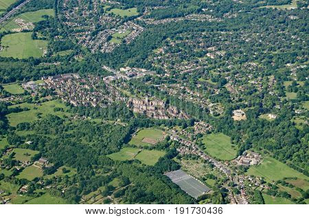 View from a plane of the Surrey town Virginia Water a wealthy residential area. The landmark Victorian Gothic former Holloway Sanatorium is towards the middle of the image it has been converted to a high class residential development.