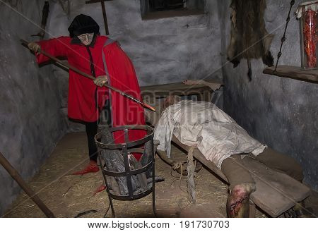 Castle Loket Czech Republic- September 19 2016: scene of medieval torture in prison cell of Loket Castle.