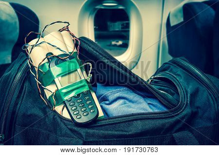 Dynamite bomb with phone in terrorist bag inside airplane - retro style