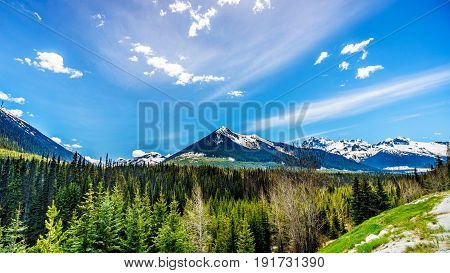 View of the snow capped Coast Mountains along Highway 99, also called The Duffey Lake Road, winds its way through the Coast Mountain Range between Pemberton and Lillooet in southern British Columbia