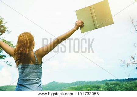 women relax read a book Mountain nature. Happy healthy climate