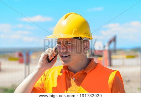 Young Construction Worker Talking On A Mobile