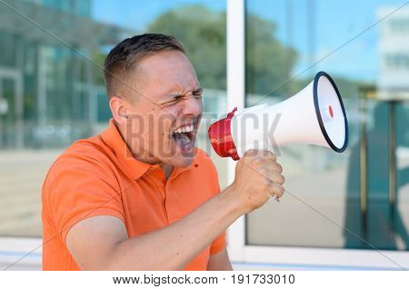 Man Screaming Through The Megaphone