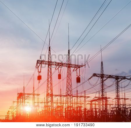Electrical substation on the sunset background close up