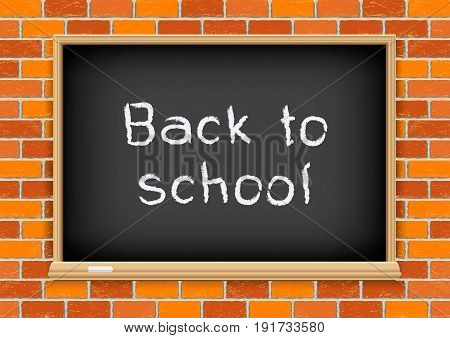 Blackboard with text message back to school on old red brick background texture. School education object