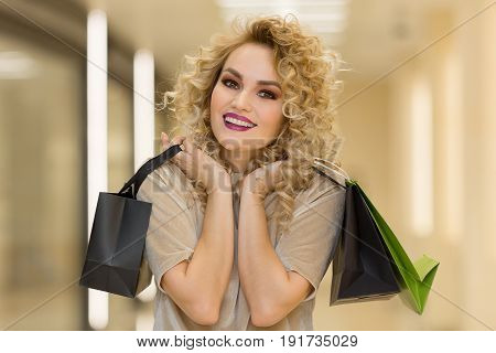 Very Happy Beautiful Young Woman In Casual Clothing With Shopping Bags, At Centre Or Mall.
