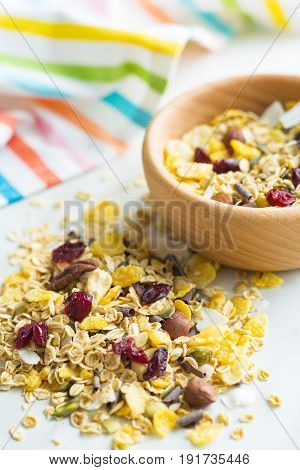 Tasty homemade muesli with nuts on kitchen table.