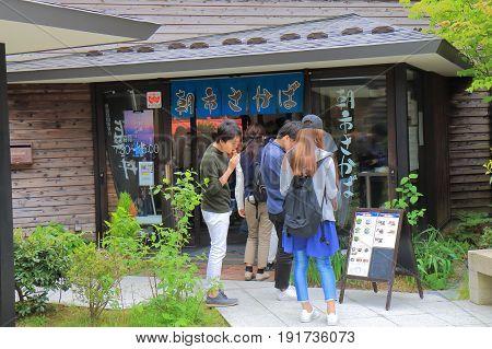 ISHSIKAWA JAPAN - MAY 5, 2017: Unidentified people visit a restaurant sake bar at Wajima Asaishi street market. Asaichi is one of the top 3 mating street market in Japan.