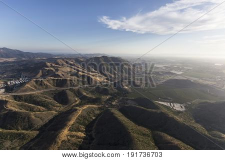 Aerial of hills and 101 freeway between Thousand Oaks and Camarillo in Ventura County, California.