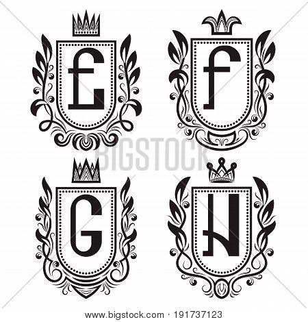Royal coat of arms set in medieval style. Vintage logos with E F G H monogram.