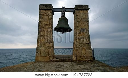Fog Bell in the old town of Chersonesus Tavrichesky on the shore of the Black sea. Russia, Crimea