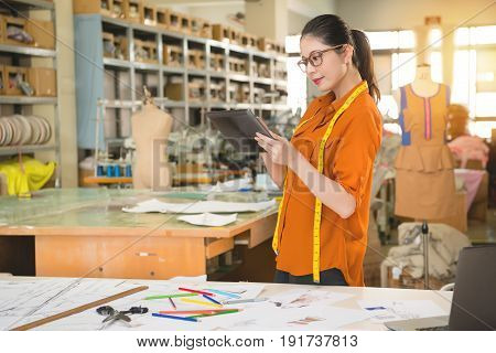 Woman Designer Using Digital Table Touch Pad