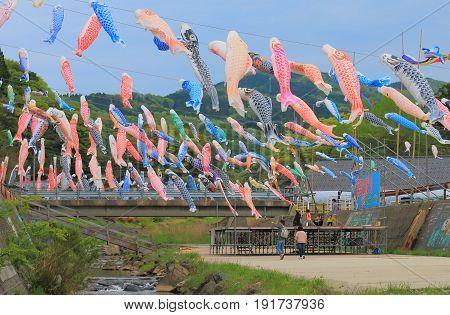 ISHSIKAWA JAPAN - MAY 5, 2017: Unidentified people visit Koinobori festival in Wajima Ishikawa. Koinobori is carp shaped wind socks traditionally flown in Japan to celebrate Tango no sekku children's day.