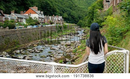 girl looking up the valley of the East Lyn River in Lynmouth in North Devon England UK