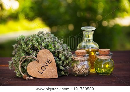 Natural herbs and oils. Aromatic thyme and magic elixir. The love drink. Love potion. Alternative medicine.