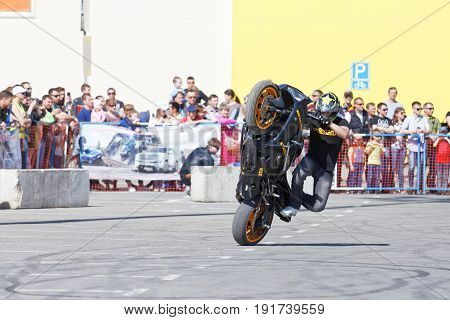 A Motorcycle Rider Make Wheelie On The Bike