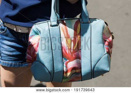 MILAN ITALY - JUNE 18: Detail of bag outside Ferragamo fashion show during Milan Men's Fashion Week on JUNE 18 2017 in Milan.