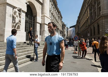 MILAN ITALY - JUNE 18: Fashionable man poses outside Ferragamo fashion show during Milan Men's Fashion Week on JUNE 18 2017 in Milan.