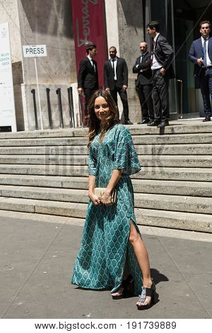 MILAN ITALY - JUNE 18: Fashionable woman poses outside Ferragamo fashion show during Milan Men's Fashion Week on JUNE 18 2017 in Milan.