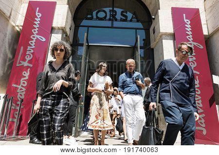 MILAN ITALY - JUNE 18: Fashionable people gather outside Ferragamo fashion show during Milan Men's Fashion Week on JUNE 18 2017 in Milan.