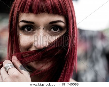 Redhead woman portrait face with freckles and piercing