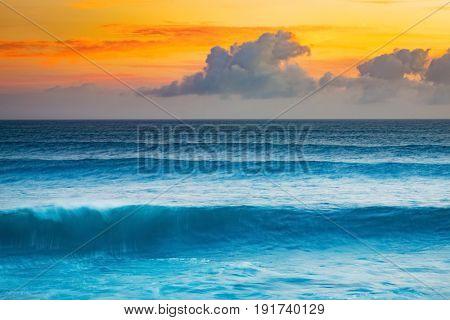 Big wave of Indian ocean at sunset. Gris Gris Beach. Mauritius